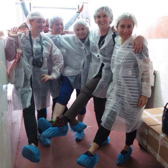 Jamon-ing it up in hairnets for a ham factory tour.