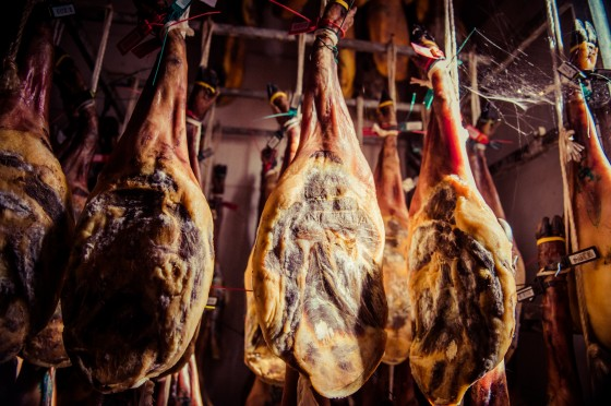 Jamon iberico getting a leg up in the curing process. by Renegade Photo